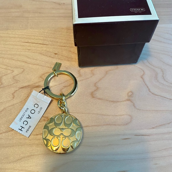 Coach keychain NWT - gold locket